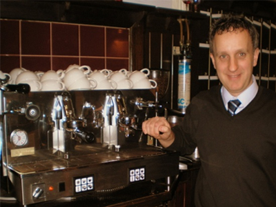 Matthew, general manager of the King's Head Hotel and Restaurant standing next to his Ducale 2 Group espresso machine